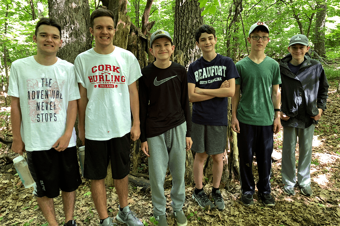 Teens standing in woods at nature center